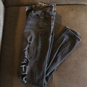Skinny black ripped jeans.